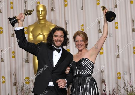 "Sean Fine and Andrea Nix Fine pose with their award for best documentary short subject for ""Inocente"" during the Oscars at the Dolby Theatre, in Los Angeles"