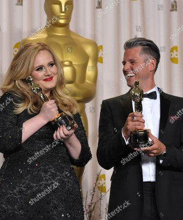 "Adele and Paul Epworth pose with their award for best original song for ""Skyfall"" during the Oscars at the Dolby Theatre, in Los Angeles"