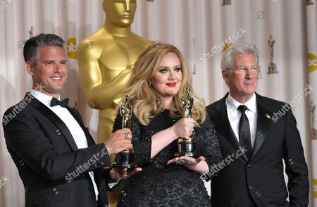 "Adele, Paul Epworth with their award for best original song for ""Skyfall"", and presenter Richard Gere pose during the Oscars at the Dolby Theatre, in Los Angeles"