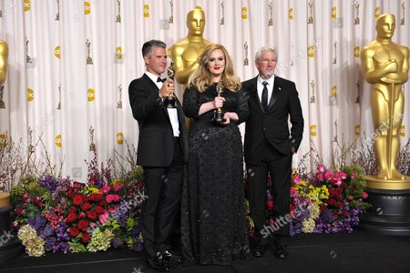 Paul Epworth, left, Adele, and Richard Gere in the press room at the Oscars at the Dolby Theatre, in Los Angeles