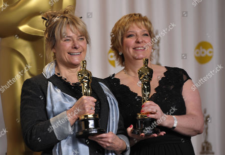 "Stock Photo of SCIENCES FOR USE UPON CONCLUSION OF THE ACADEMY AWARDS TELECAST ** Julie Dartnell, left, and Lisa Westcott pose with their award for best makeup and hairstyling for ""Les Miserables"" during at the Oscars at the Dolby Theatre, in Los Angeles"