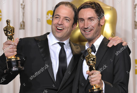 """Producer Simon Chinn, left, and actor Malik Bendjelloul pose with their award for best documentary feature for """"Searching for Sugar Man"""" during the Oscars at the Dolby Theatre, in Los Angeles"""
