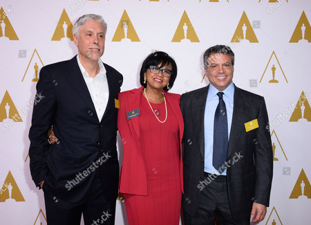 Christopher Rouse, President of the Academy Cheryl Boone Isaacs and Michael De Luca arrive at the 86th Oscars Nominees Luncheon, on Monday, Feb., 10, 2014 in Beverly Hills, Calif