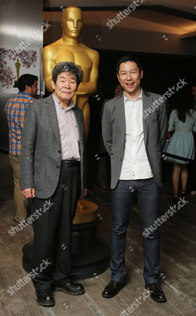 Isao Takahata, left, and Yoshiaki Nishimura, arrive at 87th Academy Awards - Animated Features at Samuel Goldwyn Theater, in Beverly Hills, Calif