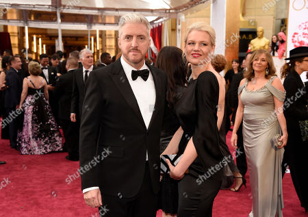 Anthony McCarten, left, and Jane Hawking arrive at the Oscars, at the Dolby Theatre in Los Angeles