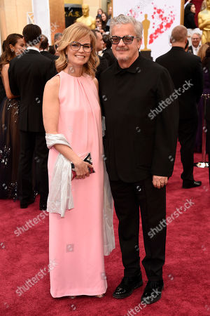 Anita Greenspan, left, and Mark Mothersbaugh arrive at the Oscars, at the Dolby Theatre in Los Angeles