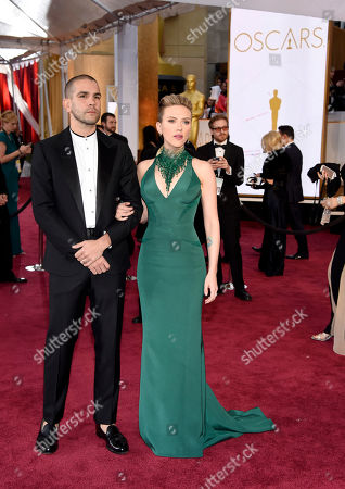 Stock Image of Romain Dauriac, left, and Scarlett Johansson arrive at the Oscars, at the Dolby Theatre in Los Angeles