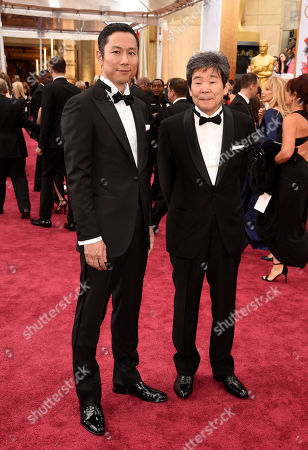 Isao Takahata, left, and Yoshiaki Nishimura arrive at the Oscars, at the Dolby Theatre in Los Angeles