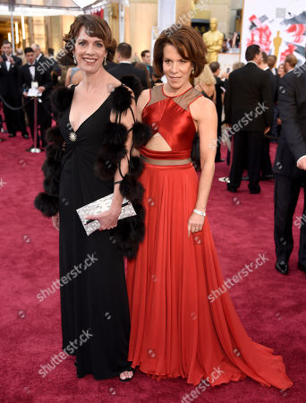 Dana Perry, left, and Ellen Goosenberg Kent arrive at the Oscars, at the Dolby Theatre in Los Angeles