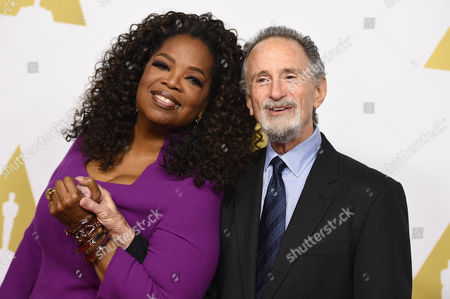 Oprah Winfrey, left, and Lawrence Gordon arrive at the 87th Academy Awards nominees luncheon at the Beverly Hilton Hotel, in Beverly Hills, Calif