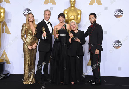 Margot Robbie, left, and Jared Leto, right, pose in the press room with Damian Martin, from second left, Lesley Vanderwalt and Elka Wardega, winners of the award for best makeup and hairstyling for Mad Max: Fury Road, at the Oscars, at the Dolby Theatre in Los Angeles