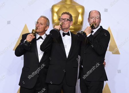 Ben Osmo, from left, Gregg Rudloff and Chris Jenkins, winners of the award for best sound mixing for Mad Max: Fury Road pose in the press room at at the Oscars, at the Dolby Theatre in Los Angeles