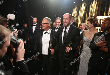 Ben Osmo, left, Gregg Rudloff and Chris Jenkins appear backstage with the award for best sound mixing for Mad Max: Fury Road, at the Oscars, at the Dolby Theatre in Los Angeles