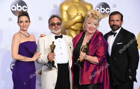 Tina Fey, left, and Steve Carell, right, pose in the press room with Colin Gibson, left, and Lisa Thompson, winners of the award for best production design for â?œMad Max: Fury Roadâ??, at the Oscars, at the Dolby Theatre in Los Angeles