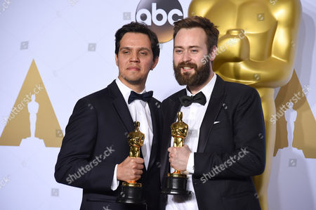 Shan Christopher Ogilvie, left, and Benjamin Cleary pose in the press room with the award for best live action short film for Stutterer at the Oscars, at the Dolby Theatre in Los Angeles