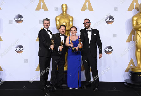 Mark Ardington, from left, Paul Norris, Sara Bennett and Andrew Whitehurst pose with the award for best visual effects for Ex Machina in the press room at the Oscars, at the Dolby Theatre in Los Angeles