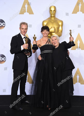 Damian Martin, from left, Lesley Vanderwalt and Elka Wardega pose with the award for best makeup and hairstyling for Mad Max: Fury Road at the Oscars, at the Dolby Theatre in Los Angeles