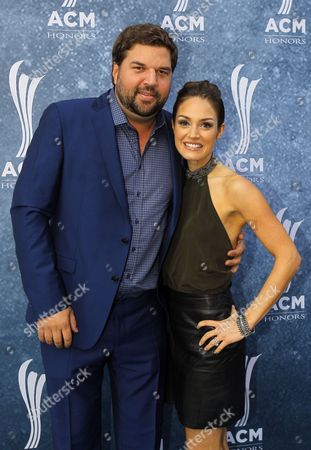Dallas Davidson and his wife, Natalia Starzynski arrive at the 9th Annual ACM Honors at The Ryman Auditorium on in Nashville, Tenn