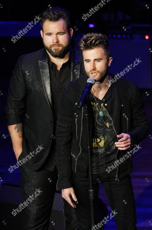 Zach Swon speaks as his brother Colton Swon looks on at the 9th Annual ACM Honors at The Ryman Auditorium on in Nashville, Tenn