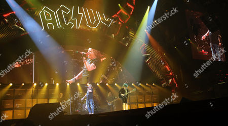 Stock Photo of Angus Young, Cliff Williams, Axl Rose and Chris Slade with AC/DC performs at Philips Arena, in Atlanta