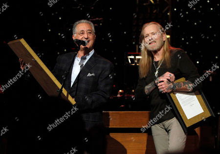 Stock Photo of Gregg Allman received an award from Del Bryant, President of BMI during the show at All My Friends: Celebrating The Songs and Voice of Gregg Allman on in Atlanta, Ga