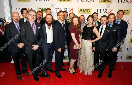 """AMC Head of Scripted Programming Joel Stillerman, left, and AMC President Charlie Collier, right, pose for a photo with the Executive Producers and Cast of AMC's new series """"TURN"""" at the premiere of AMC's TURN at The National Archives on in Washington, DC"""