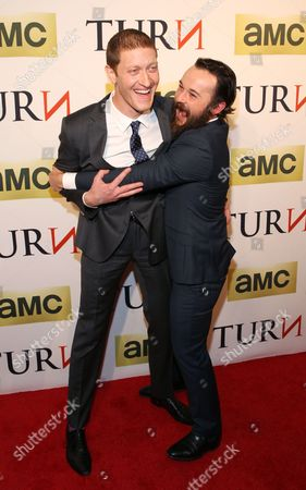 Actors Samuel Roukin, left, and Daniel Henshall attend the premiere of AMC's new series TURN at The National Archives on in Washington, DC