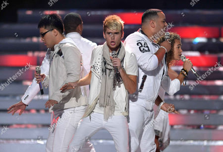 From left, Heejun Han, Colton Dixon, Jeremy Rosado and Deandre Brackensick perform onstage at the American Idol Finale on in Los Angeles