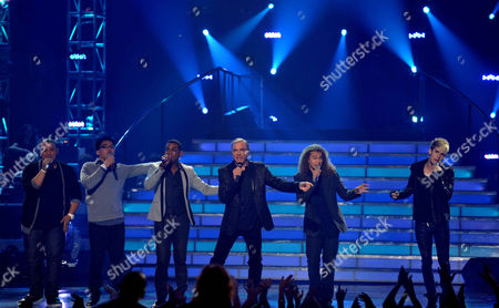 From left, Jeremy Rosado, Heejun Han, Joshua Ledet, Neil Diamond, Deandre Brackensick and Colton Dixon perform onstage at the American Idol Finale on in Los Angeles