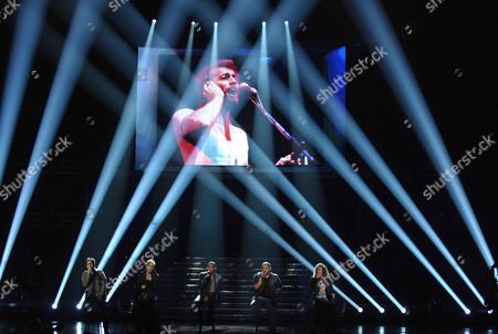 From left, Heejun Han, Colton Dixon, Joshua Ledet, Jeremy Rosado and Deandre Brackensick perform a tribute to Robin Gibb onstage at the American Idol Finale on in Los Angeles