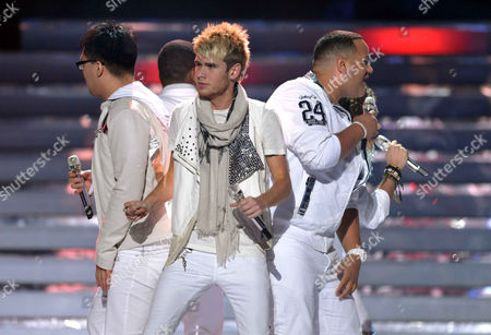 From left, Heejun Han, Colton Dixon and Jeremy Rosado perform onstage at the American Idol Finale on in Los Angeles