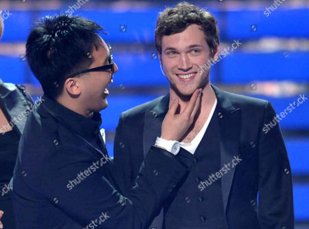Heejun Han, left, congratulates winner Phillip Phillips after the results are announced onstage at the American Idol Finale on in Los Angeles