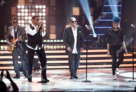 Tito Jackson, from left, Jackie Jackson and Marlon Jackson, of The Jackson Five, and Tyanna Jones perform at the American Idol XIV finale at the Dolby Theatre, in Los Angeles