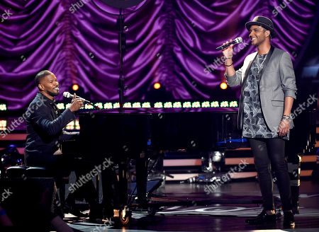 Jamie Foxx, left, and Rayvon Owen perform at the American Idol XIV finale at the Dolby Theatre, in Los Angeles