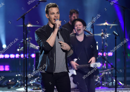 Finalist Clark Beckham performs at the American Idol XIV finale at the Dolby Theatre, in Los Angeles. Looking on at right is Patrick Stump of Fall Out Boy