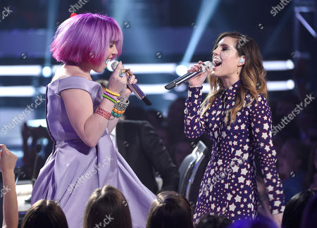 Joey Cook, left, and Sydney Sierota of Echosmith perform at the American Idol XIV finale at the Dolby Theatre, in Los Angeles