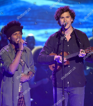 Quentin Alexander, left, and Vance Joy perform at the American Idol XIV finale at the Dolby Theatre, in Los Angeles