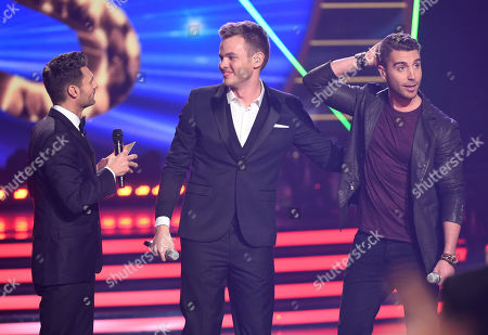 Clark Beckham, center, and Nick Fradiani, right, react after host Ryan Seacrest announces Fradiani as the winner at the American Idol XIV finale at the Dolby Theatre, in Los Angeles