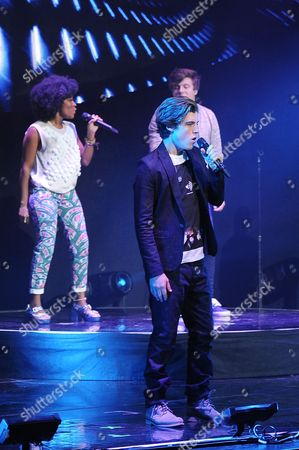 Stock Picture of EXCLUSIVE IMAGE Malaya Watson, Sam Woolf, and Alex Preston perform during American Idols Live! 2014 at the Broward Center for the Performing Arts on in Ft Lauderdale, Florida. (Photo by