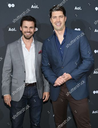 Actor Tommy Dewey, left, and Tug Coker attend the AOL NewFront at the South Street Seaport, in New York