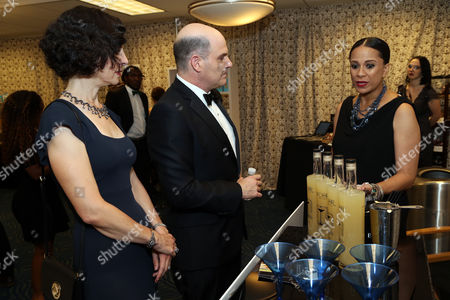 Matthew Weiner, center, and Linda Brettler in Backstage Creations Giving Suites at the 67th Primetime Emmy Awards at the Microsoft Theatre L.A. Live, in Los Angeles