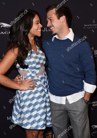 Gina Rodriguez, left, and Henri Esteve arrive at the BAFTA 2015 awards season tea party at The Four Seasons Hotel, in Los Angeles