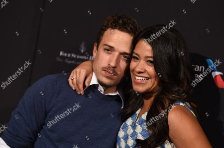 Gina Rodriguez, right, and Henri Esteve arrive at the BAFTA 2015 awards season tea party at The Four Seasons Hotel on in Los Angeles
