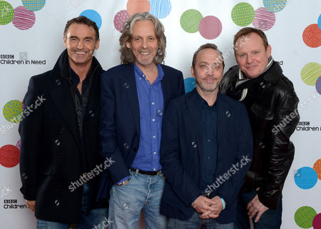 Wet Wet Wet, from left to right Marti Pellow, Graeme Clark, Neil Mitchell and Tommy Cunningham pose backstage at the BBC Children in Need Appeal Show, live from BBC Elstree Studios in London, on