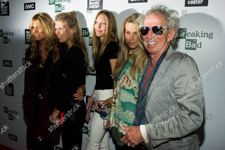 "Stock Image of Keith Richards, right, his daughter Theodora, granddaughter Ella Rose, daughter Alexandra Richards, and wife Patti Hansen attend the ""Breaking Bad"" final episodes premiere hosted by the Film Society of Lincoln Center on in New York"