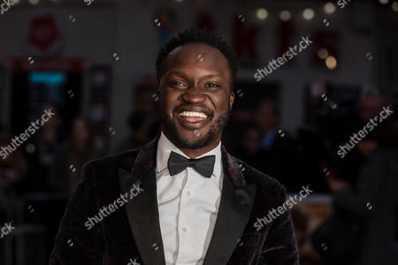 Actor Arnold Oceng poses for photographers on arrival at the premiere of the film 'A United Kingdom', which opens the London Film Festival in London, . The festival runs from Oct. 5 until Oct. 16