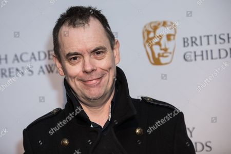 Kevin Eldon poses for photographers upon arrival at the BAFTA Children's awards, in London