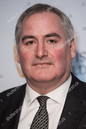 Chris Riddell poses for photographers upon arrival at the BAFTA Children's awards, in London