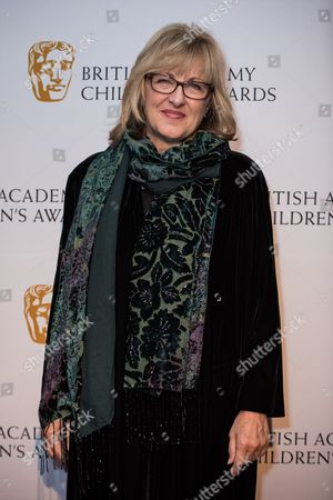 Janet Healy poses for photographers upon arrival at the BAFTA Children's awards, in London