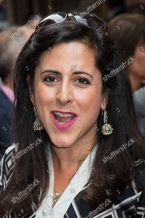 Stock Picture of Anita Anand poses for photographers upon arrival at the premiere of the musical Bend It Like Beckham in London
